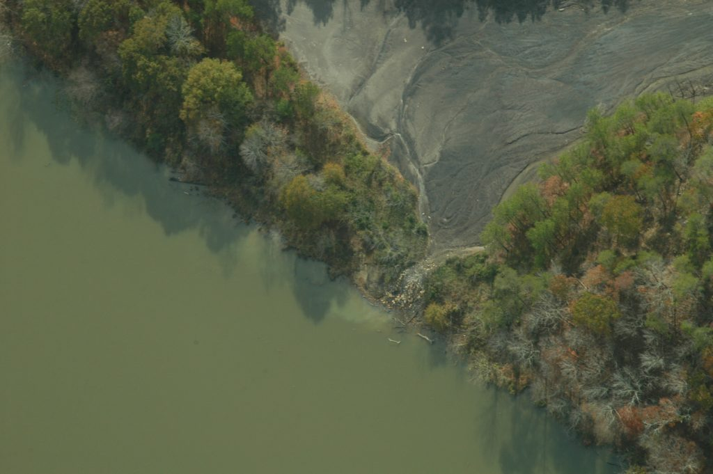 Acid mine drainage and polluted runoff from Maxine Mine entering the Locust Fork of the Black Warrior River (bottom left).  (© Nelson Brooke, Flight provided by SouthWings.org)